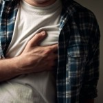 Young adult man suffering from severe heartache