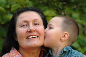 grandson kissing his granny